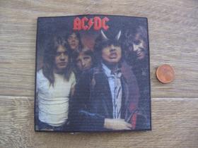 AC/DC ofsetová nášivka po krajoch neobšívaná cca. 9x9cm
